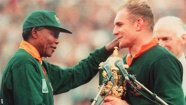 Nelson Mandela, then president of South Africa, presents the World Cup trophy to Francois Pienaar