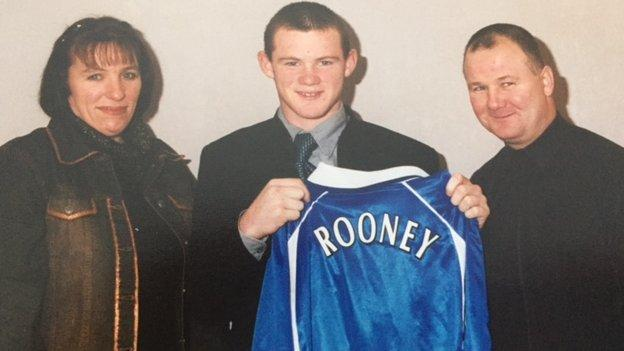 Wayne Rooney with his mum and dad