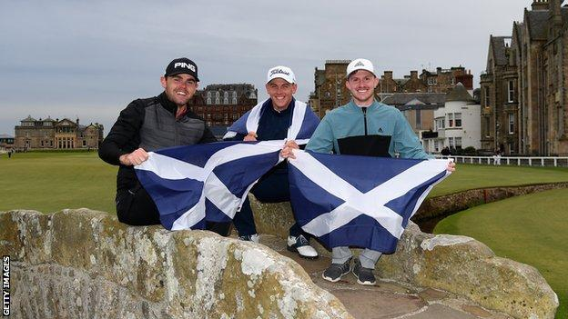 Liam Johnston, Grant Forrest and Connor Syme pose for a photo on the Swilken Bridge at St Andrews
