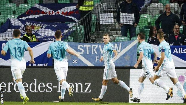 Roman Bezjak (centre) changed the game with two second-half goals for Slovenia