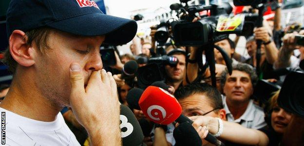 Sebastian Vettel faces the media after colliding with team-mate Mark Webber in Turkey in 2010