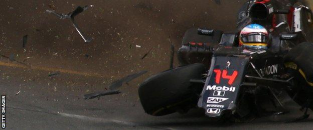 Fernando Alonso hits the wall