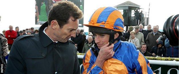 Trainer Aidan O'Brien talks to winning jockey Ryan Moore after Order of St George's Irish St Leger win