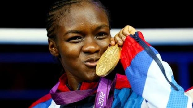 Nicola Adams kisses her first ever gold medal.