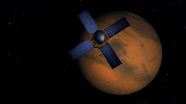 Mariner 4 flies by Mars