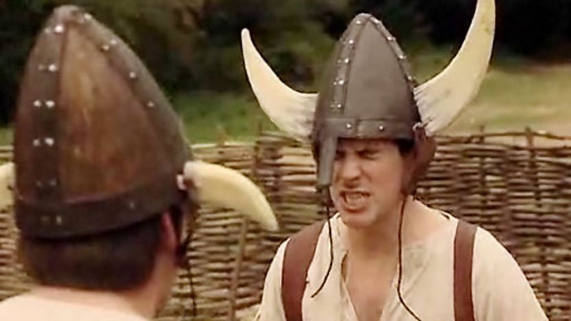 Dick and Dom wearing Viking helmets.
