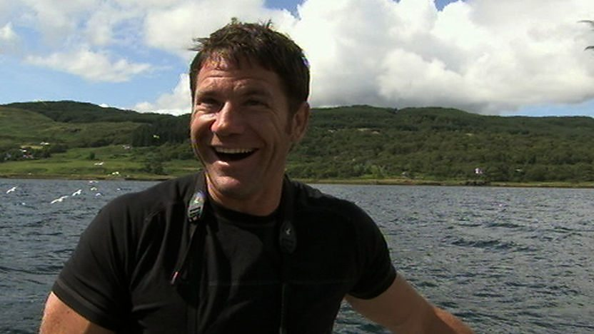 Steve Backshall smiling on a boat