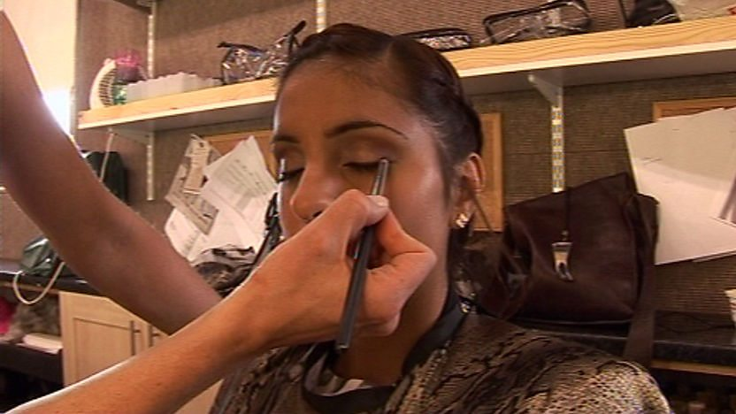 Anj having her make up done.