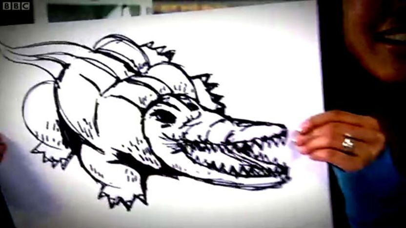 hands drawing a crocodile