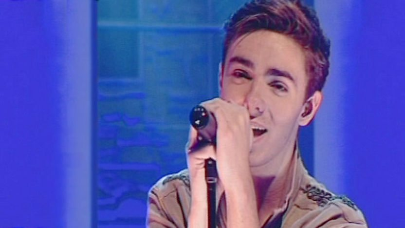 Nathan singing, from The Wanted boy band