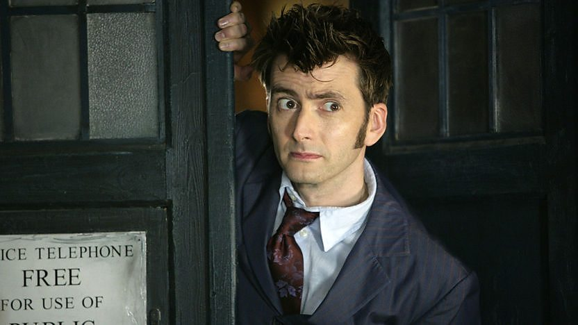 The Doctor at the TARDIS door.