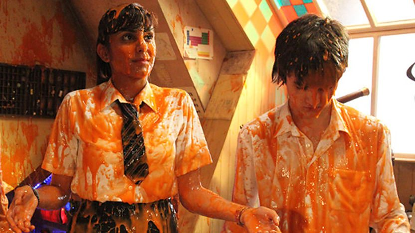 Anj and Tommy covered in alien goo.