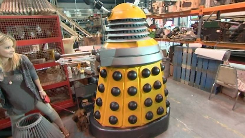 Blue Peter presenter Helen Skelton walks away form a Dalek on the set of Doctor Who.