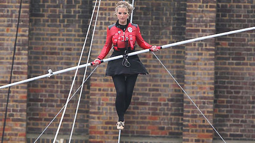 Blue Peter presenter Helen Skelton walking on a tightrope.