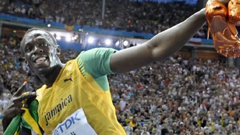 Jamaican sprinter Usain Bolt celebrating.
