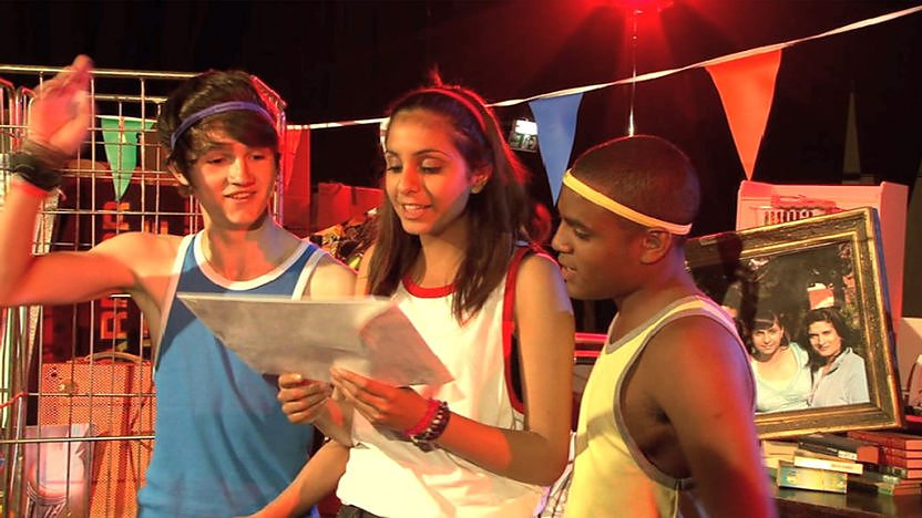 Danny, Anj and Tommy reading the challenge.