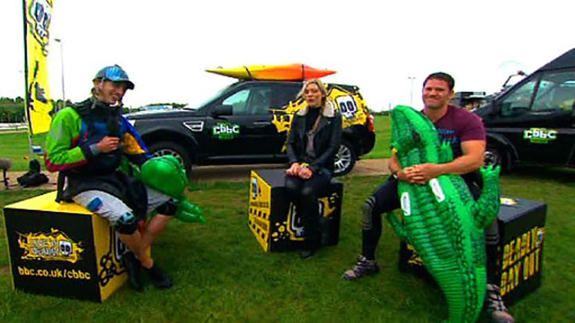 Steve Backshall and James Bebbington holding inflatable crocs and sitting with Naomi Wilkinson