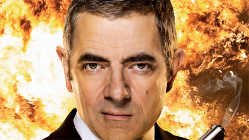 Johnny English surrounded by flames