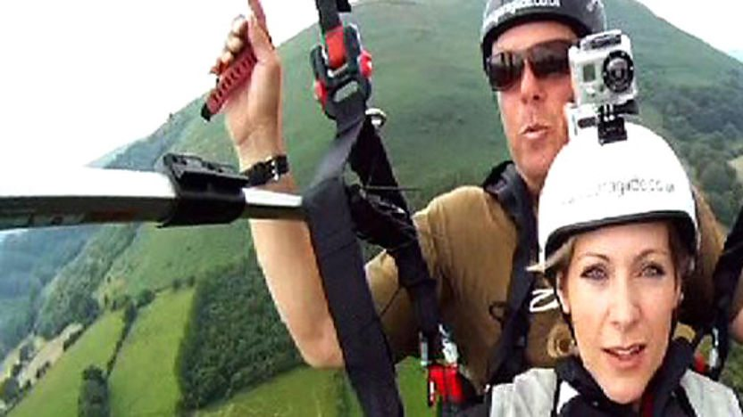 Naomi Wilkinson paragliding with an expert