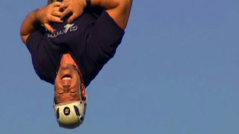 Steve Backshall hanging upside down 30 metres in the air