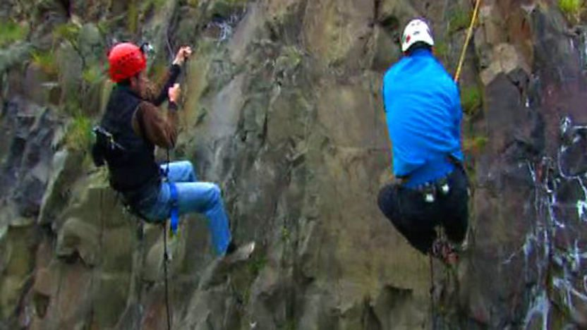 Steve Backshall racing Kenton Cool up a castle wall. 