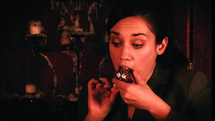 Miss McCauley from Young Dracula eating a rice cereal cake.