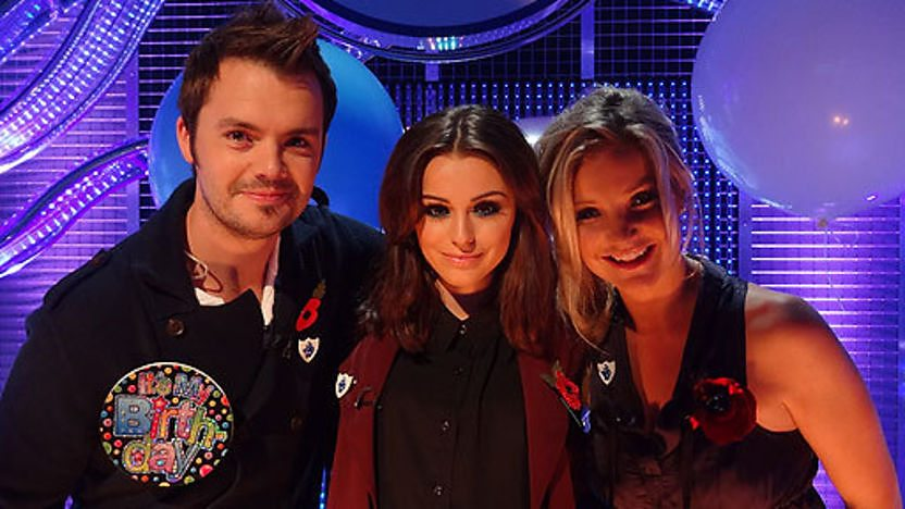 Cher Lloyd in the Blue Peter studio with presenters Barney and Helen.