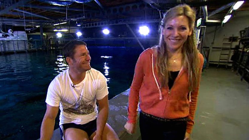 Steve Backshall and Naomi Wilkinson by a shark tank