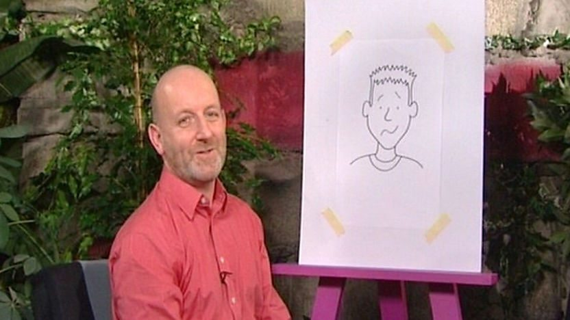 Tracy Beaker illustrator Nick Sharratt sat in front of an easel