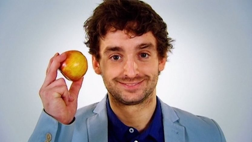 Fergus holding an apple.