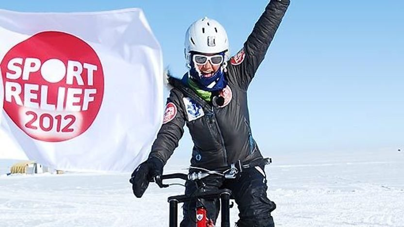 Helen Skelton punches the air as she reaches the South Pole