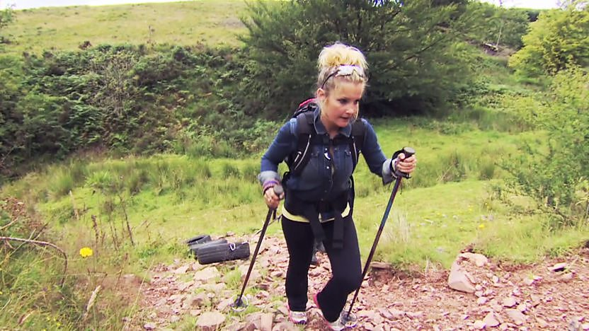 Helen Skelton pulling tyres up a hill