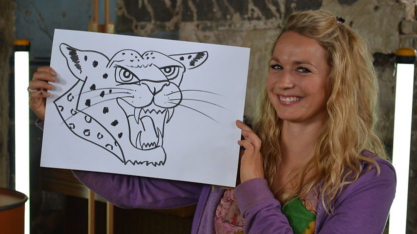 Image of Nicola with a picture of a leopard.