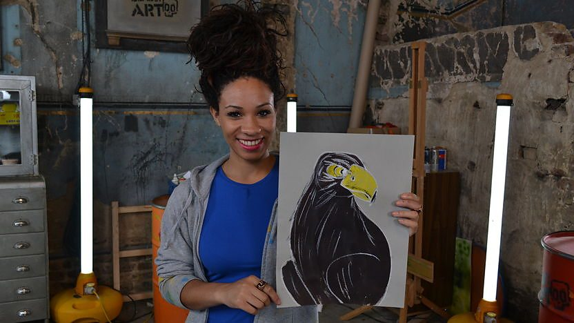 Michelle holding a drawing of a eagle.