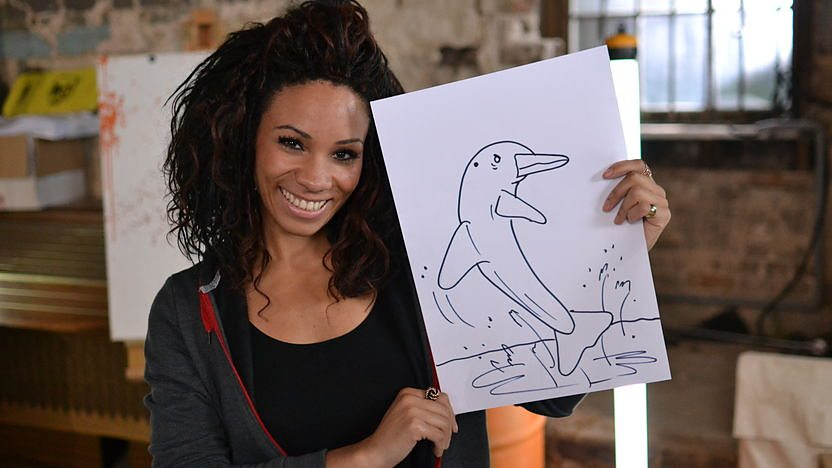 Image of Michelle with a drawing of a dolphin.