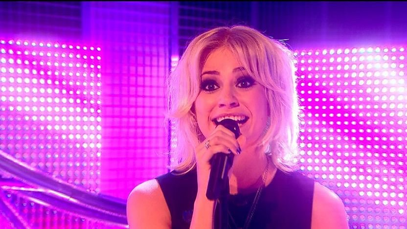 Pixie Lott singing in the Blue Peter studio.