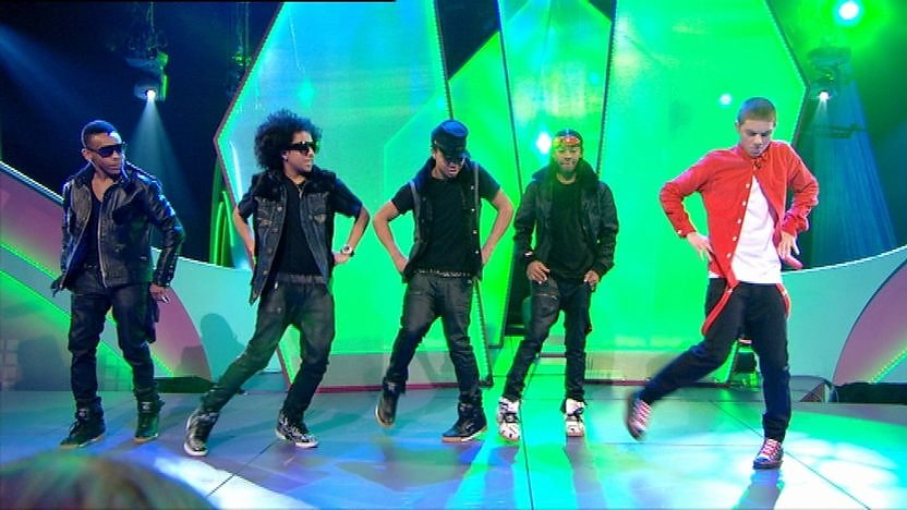 Aidan Davis and Mindless Behavior on stage dancing.