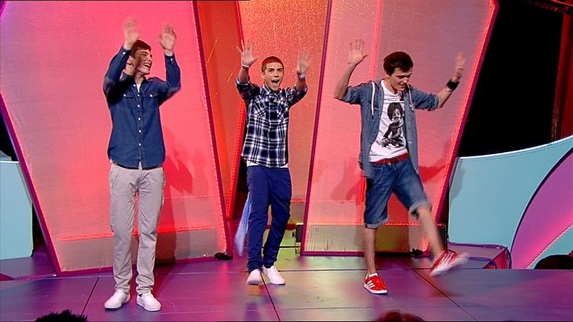Aidan Davis, Richard Wisker and George Sampson on stage dancing.