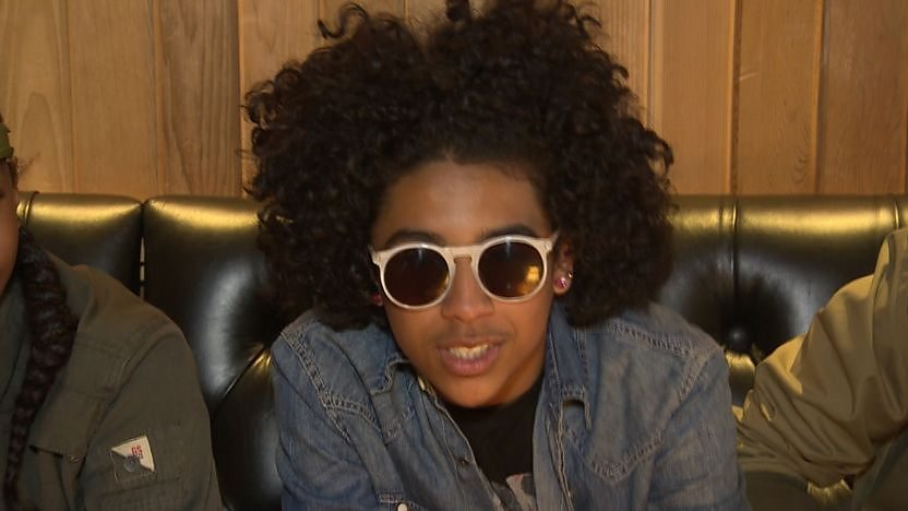 Princeton from Mindless Behavior looking into the camera while wearing sunglasses indoors.