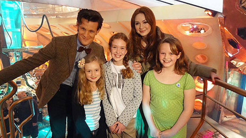 Doctor Who actor Matt Smith alongside three girls who won the &#39;Script to screen&#39; competition.