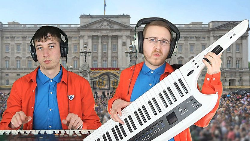 Brett Domino play their instruments in front of Buckingham Palace