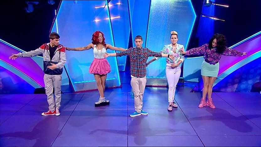 Aidan Davis, Richard Wisker and Stooshe dancing on stage.