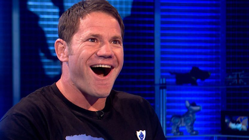 Steve Backshall laughing as he receives his gold Blue Peter badge