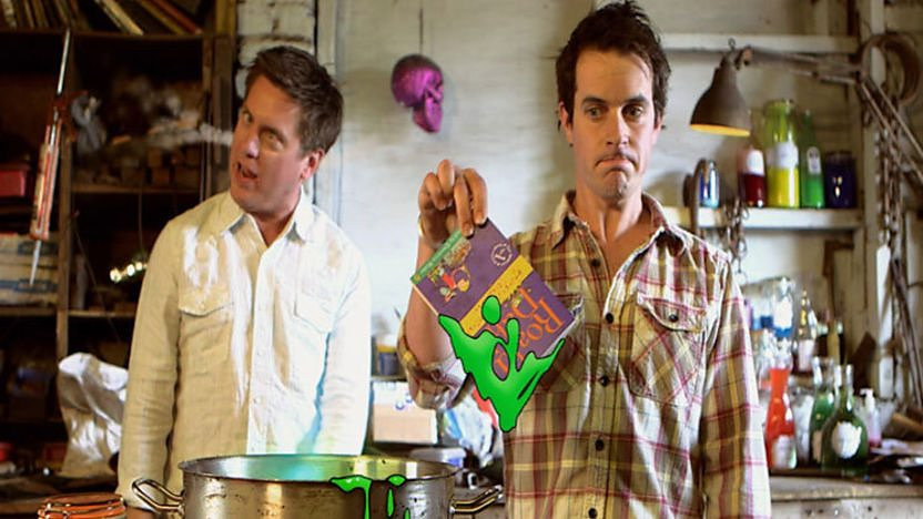 Dick and Dom acting out a scene from George's Marvellous Medicine by Roald Dahl