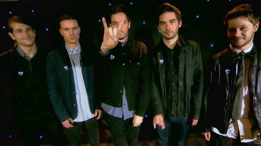 You Me At Six band members standing in a row