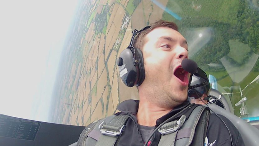 Barney harwood in an aeroplane cockpit as he performs a loop the loop
