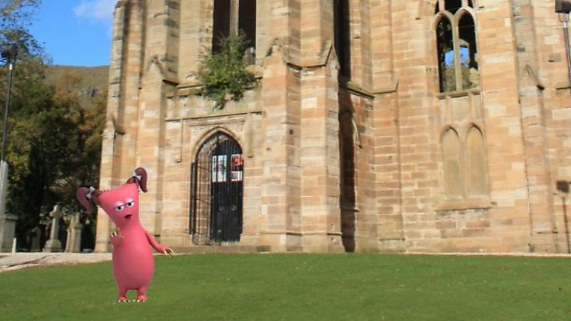 A bugbear in front of a church
