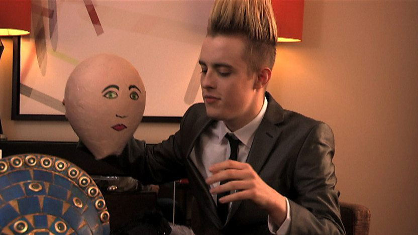 Edward holding a papier-mch head