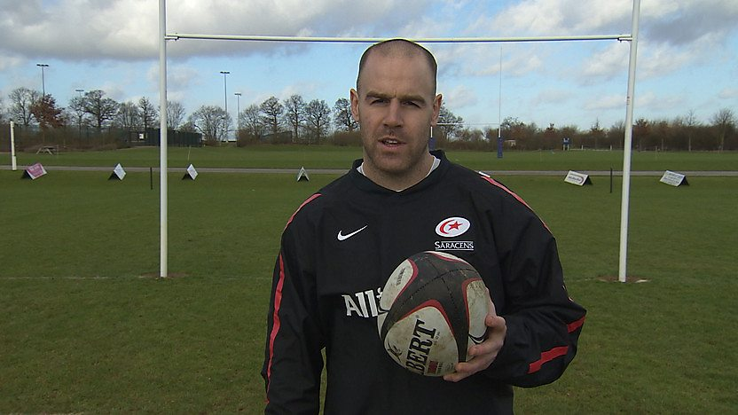 Rugby star Charlie Hodgeson holding a rugby ball