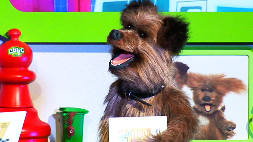 Hacker T Dog holding a Totally Rubbish quiz cue card.